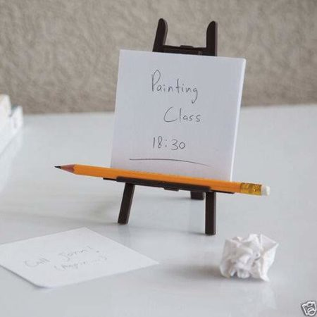 desktop easel on desk with pencil