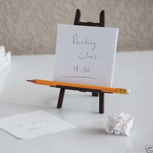 desktop easel on desk with pencil