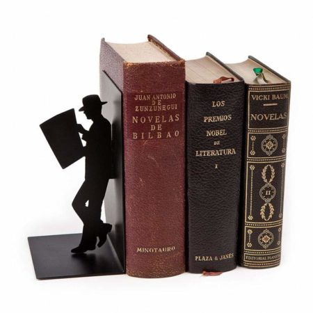 Leaning Man Bookend with old books