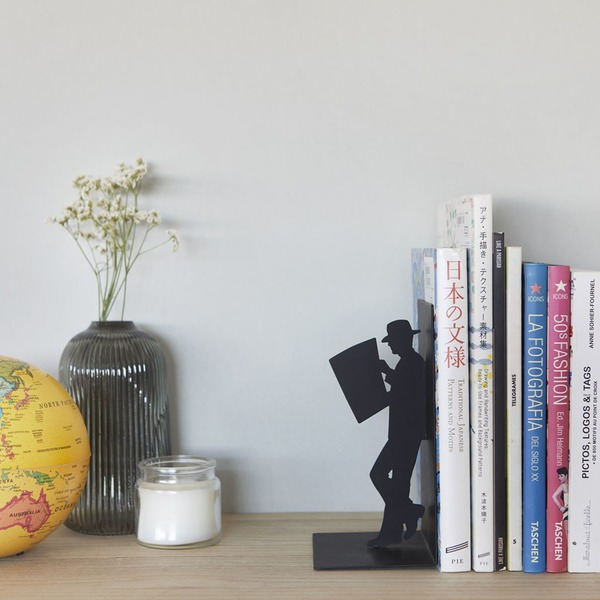 Leaning man bookend on desk