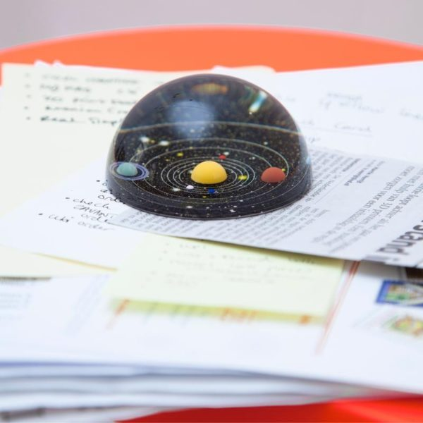 planetary solar system paperweight on desk
