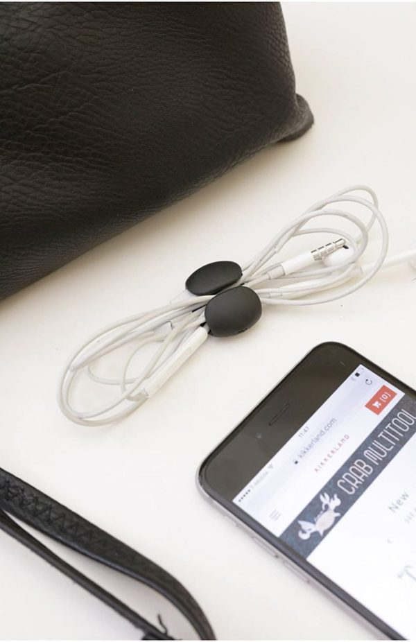 Cable management clip holding headphone wire