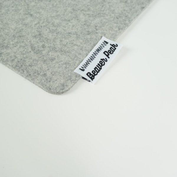 Light grey merino wool desk mat closeup
